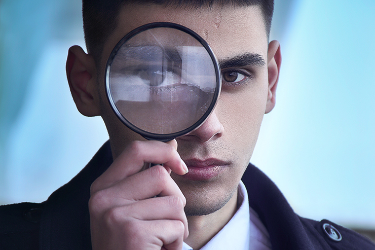 Someone looking through a magnifying glass