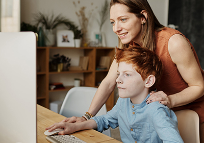 Mother and son browsing on computer